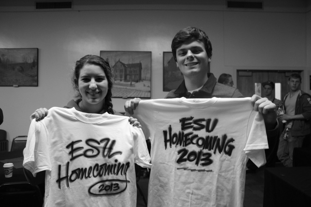 Briana Magistro and Zachary Gotthardt, holding their custom shirts. Photo Credit / Jamie Reese