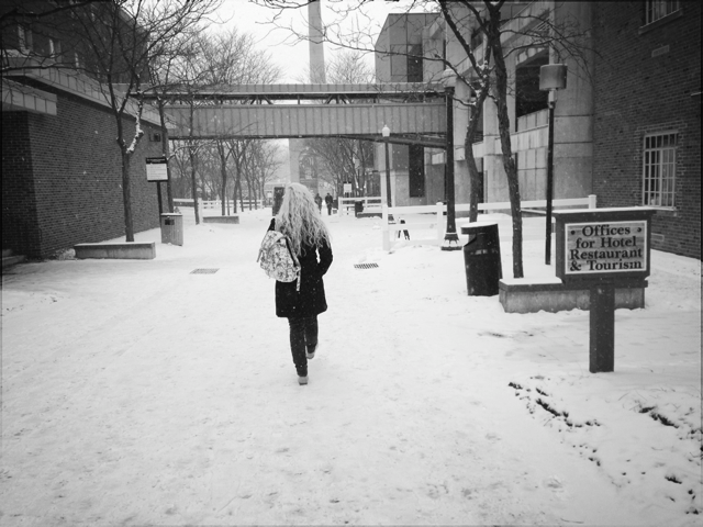 ESU Senior, Brook Wadle, braves the East Stroudsburg University campus  during harsh weather conditions. Photo Credit / Valentina Caval