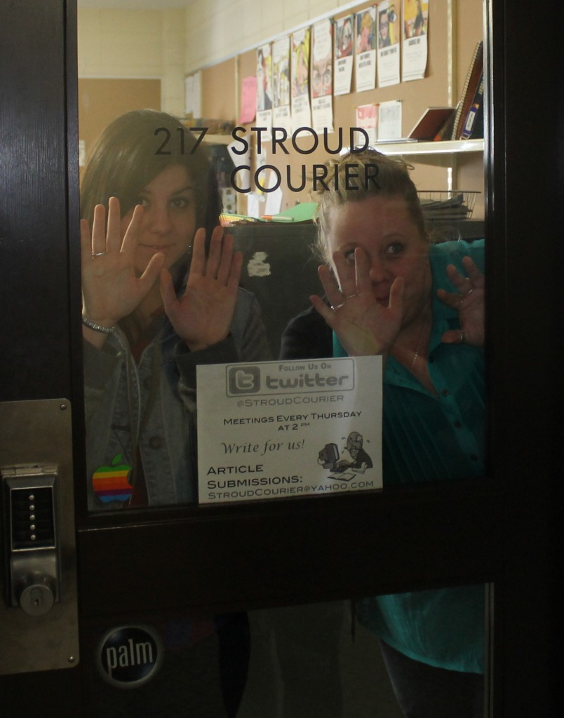 Editor-in-Chief Valentina Caval and Managing Editor Victoria Krukenkamp block the entrance to The Stroud Courier office. Photo Credit / The Stroud Courier
