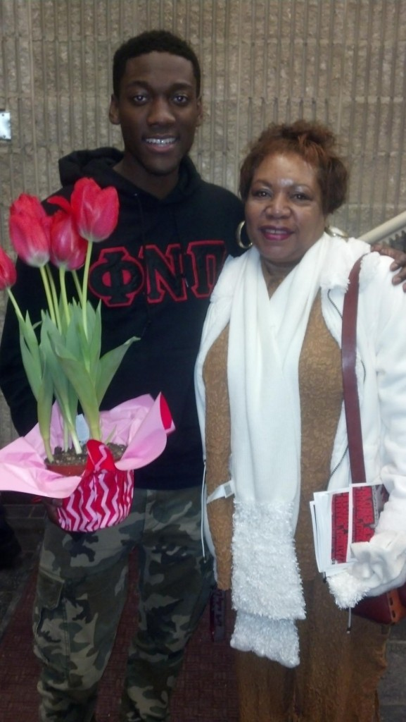 Graduate Assistant of Greek Affairs Phillip Anthony presents flowers to Dr. Patricia Graham, a retired faculty whom the step show is named after.  Photo Courtesy of Phillip Anthony