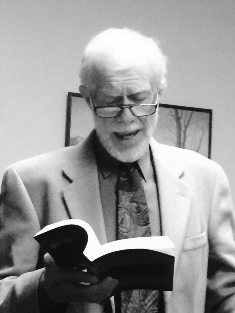 "Dr. Fred Misurella reads from ""Arrangement in Black and White."" Photo Credit / Dr. Nancy VanArsdale"