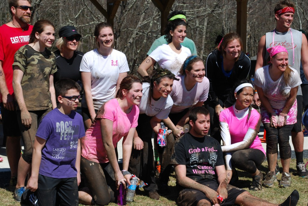 Those involved in the Diamonds in the Dirt Mudrun pose for a group photo after the run. Photo Credit / Ronald Hanaki
