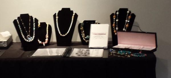 Handmade jewelry showcased at the Senior Portfolio Exhibit.  Photo Credit / Crystal Smith