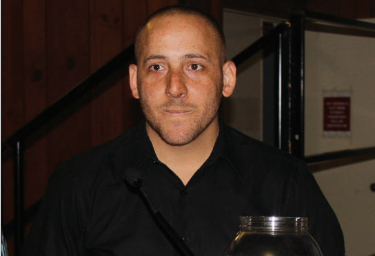 Kevin Hines raffled off copies of his book and bags of Snickers after his speech. Photo Credit / Jamie Reese