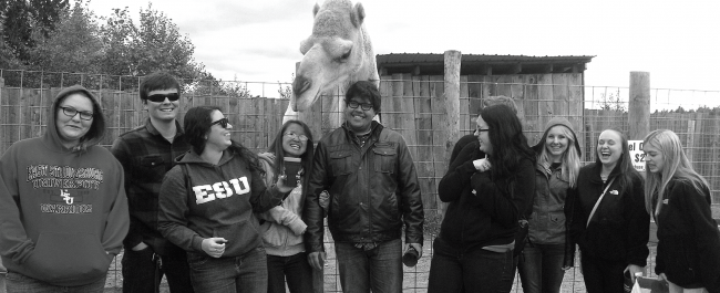 Members of ESU's Biology Club with a camel at Animal Adventure Park in New York. Photo Courtesy / Briana Magistro