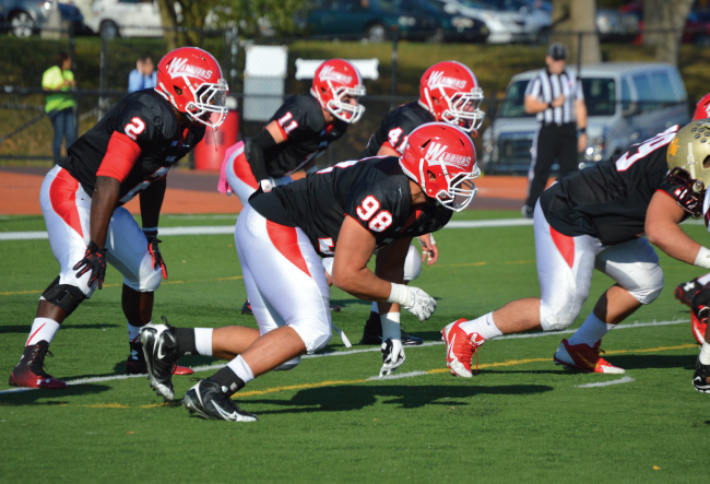 OLB Kaje Cowans (#2) and S Marc Gaudet led all defensive players with 10 tackles each in ESU's 31-16 loss to Kutztown. Photo Credit / Crystal Smith