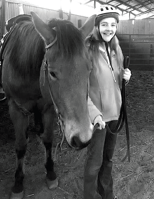 ESU senior Paige Ocker with her riding partner Zipper at Mountain View Farms in Kunkeltown. Photo Credit / Briana Magistro