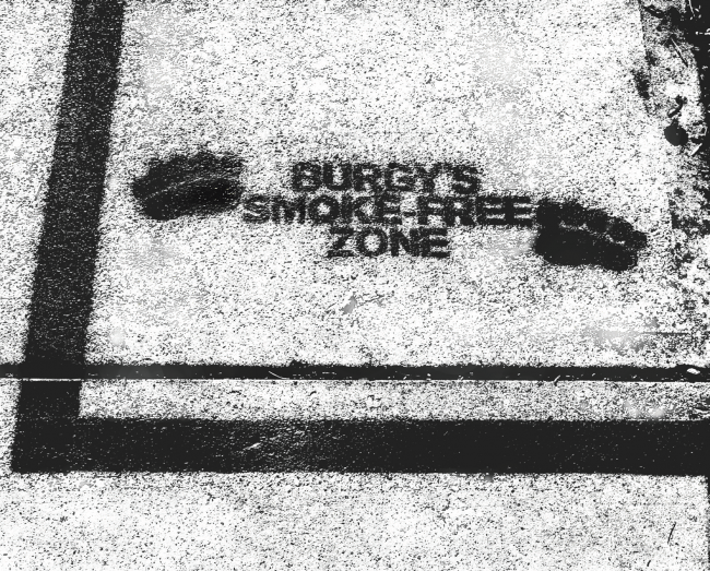 "The ""Burgy's Smoke-Free Zone"" lines are all over campus. Photo Credit / Cory Nidoh"
