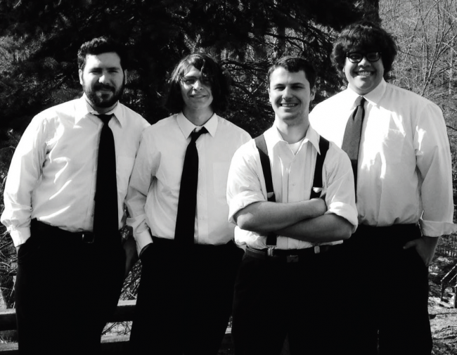 From left to right: bassist Brandon Broschart, guitarist Gage Howjnoski, utility head John Herb, and drummer Eric Kump. Nothern Revival, a local band that played at the talent show on Friday. Photo Credit / Helmut Kump