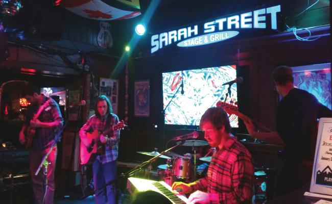Hoochie Coochie Men rockin' the Sarah Street stage on February 6. Photo Credit / Amanda Schreck