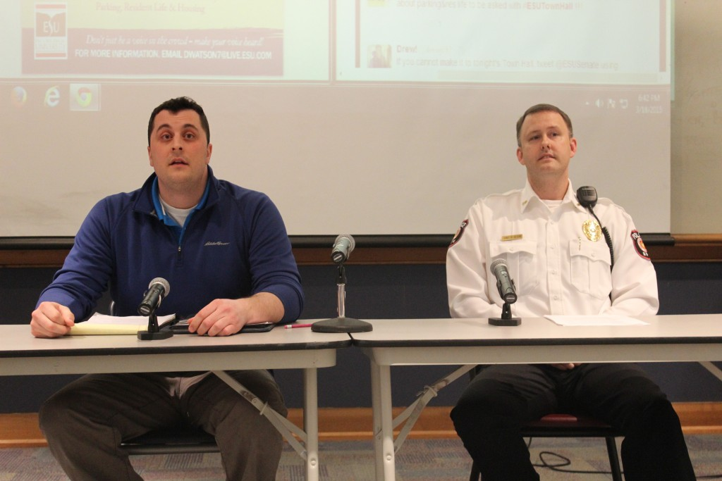 Richard Stoddard and Robin Olsen describe current parking regulations. Photo Credit / Jamie Reese