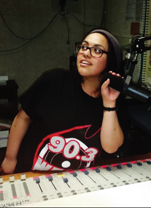 DJ Sara G. in the WESS radio studio. Photo Credit / Amanda Schreck