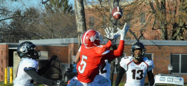 Superman Jon Schnaars beats triple coverage for one of his 16 receptions on Senior Day. Photo Credit / Lance Soodeen