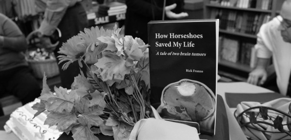 "ESU held a book signing for Rick Franzo on Nov. 18. Franzo, the manager of the consessions store in the University Center, was diagnosed with a life threatening brain tumor in 2009. His book ""How Horseshoes Saved My Life: A Tale of Two Brain Tumors,"" describes his experiences.""This book is a reflection of what I went through. Hope is real, it's a tangible thing you can wrap your arms around no matter what life throws at you,"" said Franzo. Photo Credit / William Cameron"