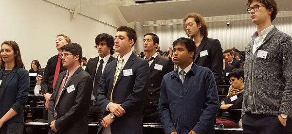 ESU senior Anthony Ruiz (back row, center) and the European Council vote in favor of passing political asylum and immigration reform at the final plenary session.Photo Credit / Ronald Hanaki