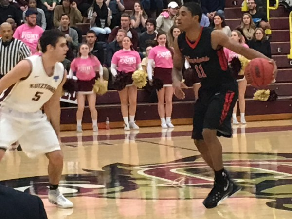 Freshman point guard Najee Walls gets ready to drive the ball against Kutztown's Austin Beidelman . Photo Credit / Ronald Hanaki