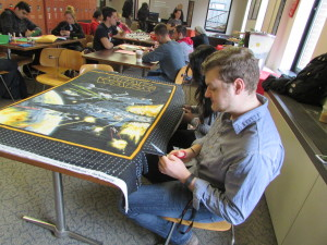 Student Senator Louie Wein puts his scissors to work on a no-sew blanket. Photo Credit / Madison Petro