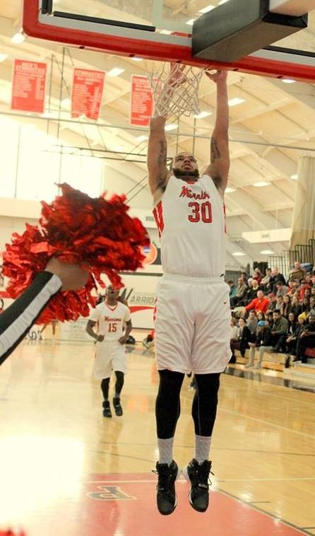 Rasheed Moore dunks. Photo Credit / Mitch Williams
