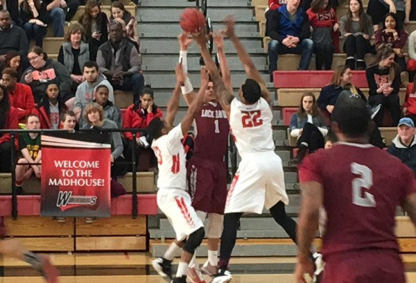 ESU's Will Brown (left) and Dajon Todmann (right) put the glove on Lock Haven's Elijah Cooper. Photo Credit / Ronald Hanaki