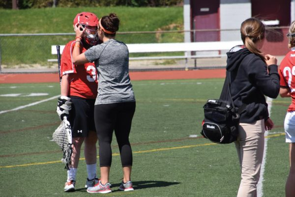 Head coach Xeni Barakos gives redshirt junior goalkeeper Jessica Maxwell a pep talk during a timeout. Photo Credit / Ronald Hanaki