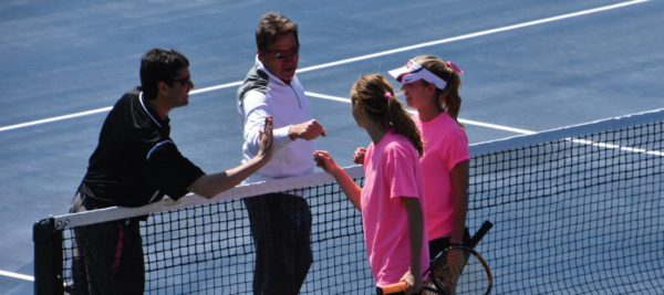 The doubles team of Presby and Bartoli celebrate their win with the coaches. Photo Credit / Ronald Hanaki