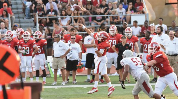 Redshirt senior quarterback Bruce Campbell threw a 52-yard TD pass to tie the game in the first quarter. Photo Credit / Ronald Hanaki