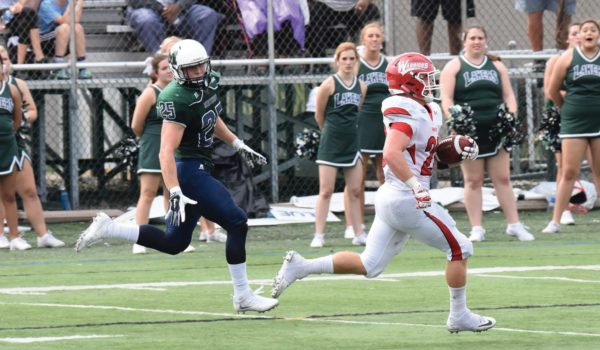 Robert Healy's 77-yard touchdown run in the fourth quarter sealed the win for the Warriors. Photo Credit / Ronald Hanaki