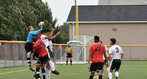 ESU goalkeeper Will Boerema makes a spectacular save against Mercyhurst. Photo Credit / Ronald Hanaki