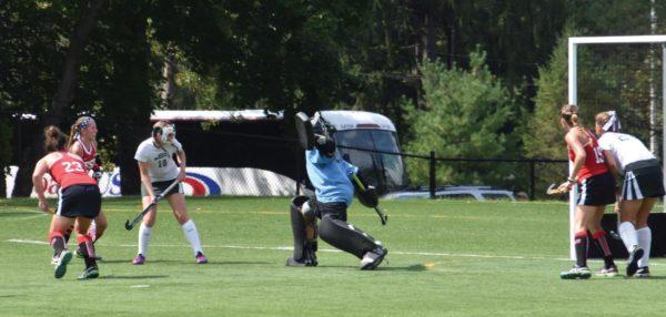 #23 Robin Stevenson (far left) scores against Mercyhurst. Photo Credit / Ronald Hanaki