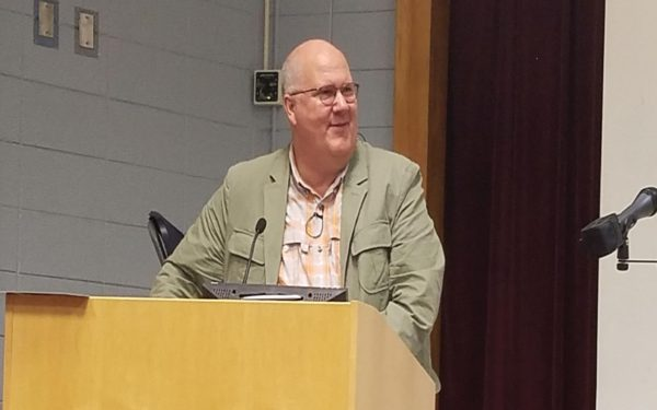 Broun takes the podium to discuss his publishing experience. Photo Credit / Kathleen Kraemer