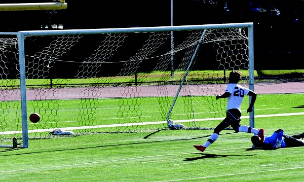 Christian Bukowski scores the first of his two goals against Seton Hill last Saturday afternoon. Photo Credit / Ronald Hanaki