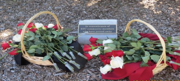 Flowers are laying by a plaque honoring those lost this past year at ESU. Photo Credit / Edita Bardhi