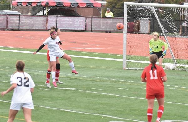 ESU senior midfielder Alyssa Simeone takes a shot. Photo Credit / Ronald Hanaki