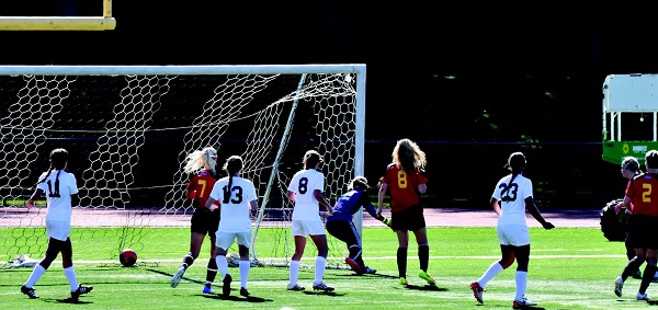 Freshman midfielder Danielle Cary scores the first goal off of a corner kick for ESU. Photo Credit / Ronald Hanaki