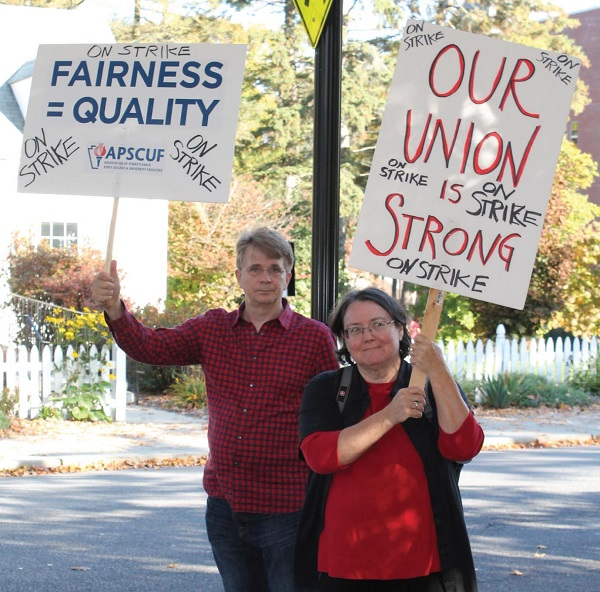 Dr. Peter Pruim and Dr. Patricia Kennedy picketing on day one of the strike. Photo Credit / Kathleen Kraemer