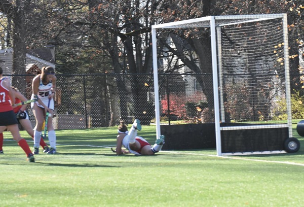 Ship happens: Ship senior Taylor Fisher lays out to make the save. Photo Credit / Ronald Hanaki
