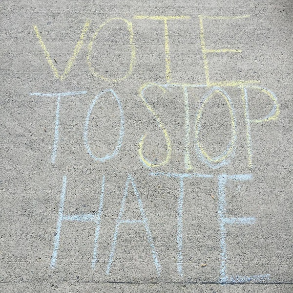 """""""Vote to Stop Hate."""" Sidewalk chalk message outside SciTech on election day, Nov. 8, 2016. Photo Credit / Rebecca Rue"""