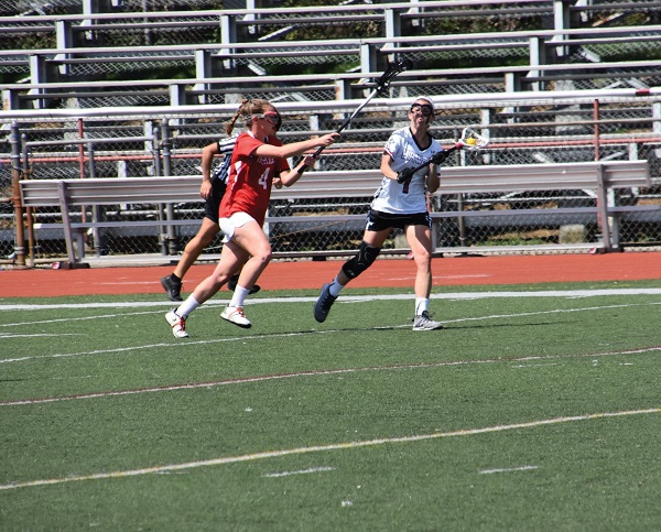 #4 Kerry Mulcahy (in red) in action against IUP. Photo Credit / Ronald Hanaki
