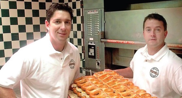 Dan DiZio and an employee at one of his franchises Photo Credit / Vimeo