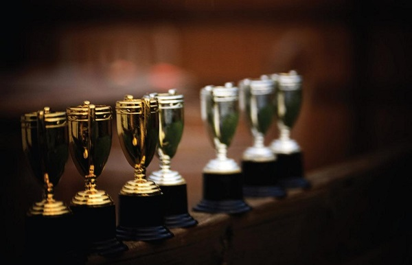 A row of standing trophies. Photo Courtesy / Flickr