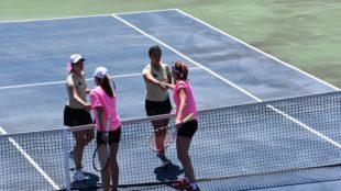 Seniors Amber Jadus and Kayla Loar shake hands with Kutztown's doubles team after the win. Photo Credit / Ronald Hanaki