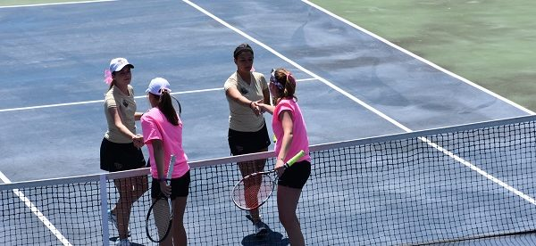 Seniors Amber Jadus and Kayla Loar shake hands with Kutztown's doubles team after the win. Photo Credit / Ronald Hanaki