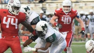 Redshirt-junior tailback #44 Jaymar Anderson (left in red) rushed 22 times for 131 yards. Photo Credit / Ronald Hanaki