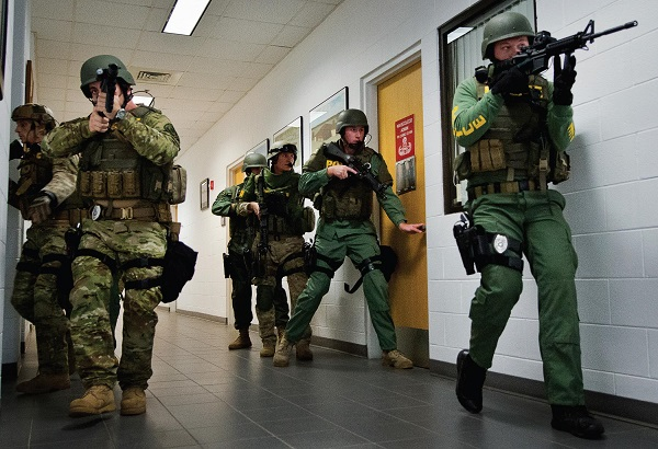 Photo Courtesy / Wikimedia Commons Frightening active shooters attend a college dorm room.