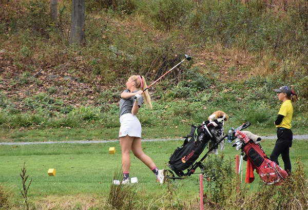 Photo Credit / Ronald Hanaki Junior Caterina Daniels tees off at the ESU Invitational.