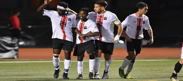 Photo Credit / Ronald Hanaki Junior forward #24 Eddy Enowbi (far left) celebrates with his teammates after scoring for ESU.