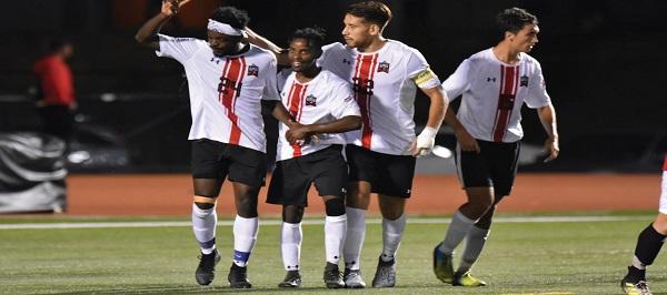 Photo Credit / Ronald Hanaki Junior forward #24 Eddy Enowbi (far left) celebrates with his teammates after scoring for ESU.