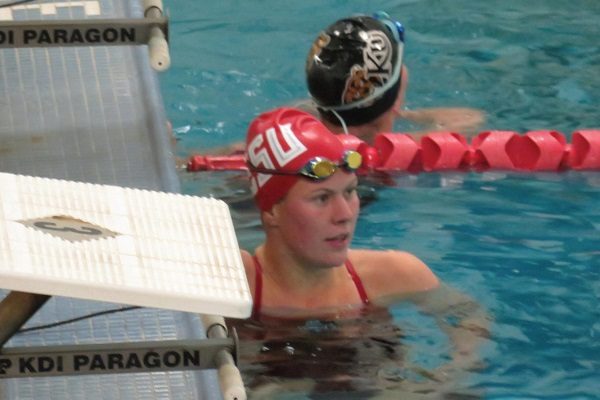 Photo Credit / Ronald Hanaki Senior Kate Zimmerman reacts after completing the 200-yard breaststroke event.