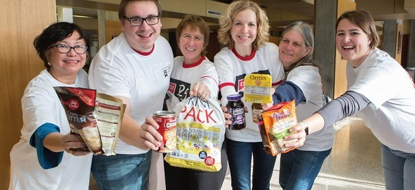 "Photo Courtesy / Brenda Friday Staff and faculty help collect non-perishables for ESU's ""Canniversary"" event."