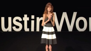 "Screen Grab From ""How Do YOU Define Yourself?"" Motivational Speaker Lizzie Velasquez talks in front of a full crowd."